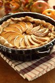 Arrangement of home-made apple pie and apples. — Stock Photo