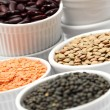 Bowls with different kinds of lentil, beans and chickpea. — Stock Photo