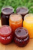 Glasses with different kinds jam. — Stock Photo