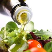 Close-up of olive oil pouring on salad. — Stock Photo