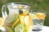 Detail of jug with fresh lemonade outdoor — Stock Photo