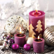 Christmas candles and ornaments — Stock Photo