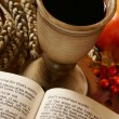 Stock Photo: Open Bible, chalice with wine, ear and apple.