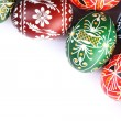 Stock Photo: Top view of Easter eggs frame on white background