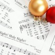 Stock Photo: Music notes with Christmas carol and Christmas ornaments