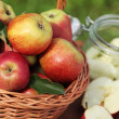 Basket with fresh apples and canning jar. — Stock Photo #26457541