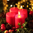 Wreath with one burning candle — Stock Photo