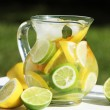Jug with fresh lemonade — Stock Photo