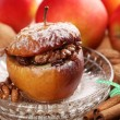 Baked stuffed apple on plate — Stock Photo