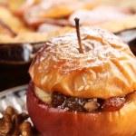 Baked stuffed apple on plate — Stock Photo #26600183