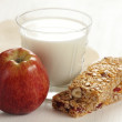 Granola bars, apple and glass of milk. — Stock Photo