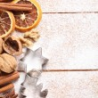 Nuts, spices and cookie cutters on sugar background — Stock Photo