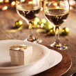 Plates, wine and Christmas decorations. — Stock Photo