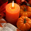 Open Bible, candle, and autumn decorations. — Stock Photo
