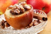 Baked apple stuffed with raisins and nuts. — Stock Photo