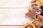 Gingerbread cookie and spices on sugar background — Stock Photo