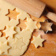 Stock Photo: Arrangement of pastry, rolling pin, and cookie cutters.