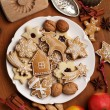 Table with cookies, apples spices and vintage cookie cutters — Stock Photo