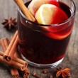 Stock Photo: Mulled wine and spices on wooden background