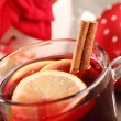 Mug with mulled wine and Christmas decorations — Stock Photo
