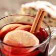 Mug with mulled wine and Christmas stollen — Stock Photo