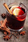 Mulled wine and spices on wooden background — Stock Photo