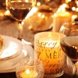 Holiday setting and decorations on table — Stok fotoğraf