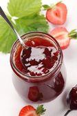Glass with strawberry jam and fresh strawberries. — Stock Photo