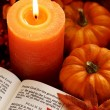 Stock Photo: Open Bible, candle, and autumn decorations.