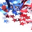 Red, white and blue stars and ribbons — Stock Photo #26876907