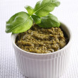 Bowl wih basil pesto, fresh basil. — Stock Photo #26976039