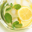 Glass jug with fresh lemonade. — Stock Photo