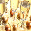 Sparklig wine and Christmas ornaments — Stock Photo