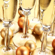Sparklig wine and Christmas ornaments — Stock Photo #27034039