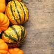 Stock Photo: Pumpkins frame on wooden table.