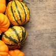 Pumpkins frame on wooden table. — Stock Photo