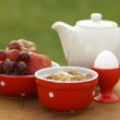 Bowl with cereal, egg, fruits and jug — ストック写真