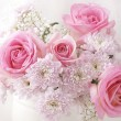 Stock Photo: Pink and white flowers in vase.