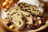 Christmas stollen, dried fruits, nuts and spices. — Stock Photo