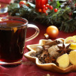 Mulled wine and spices on holiday plate. — Stock Photo