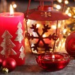 Christmas candles, lights and ornaments still life. — Stock Photo