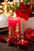 Candles and ornaments on holiday table. — Stock Photo