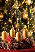 Advent wreath with Christmas tree in the background. — Stock Photo