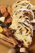 Christmas stollen, dried fruits, nuts and spices — Stock Photo