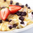 Crepes with cream, strawberries and blueberries. — Stock Photo