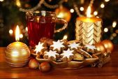 Decorative plate with Christmas cookies, tea and candles. — Stock Photo
