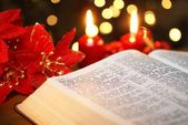 Open Bible with Christmas story and Christmas decorations — Stock Photo