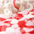 Little angels on pink and red hearts. — Stock Photo
