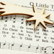 Stock Photo: Songbook with Christmas carols and christmas decoration.