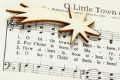 Songbook with Christmas carols and christmas decoration. — Stock Photo